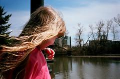 (toulouse goose) Tags: park blue portrait film 35mm kid pond kodak waterloo lamppost blonde nailpolish breezy yashicat4super ektar100 carlzeisstessar3535