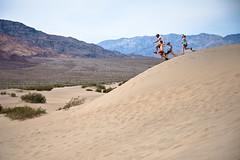 Sand Dune Jumpers (Erin Claassen Photography) Tags: california people nature rock landscape nationalpark jump sand rocks desert dune deathvalley geology sanddune deathvalleynationalpark mesquiteflatsanddunes