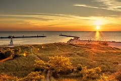 New Buffalo Harbor (batakbeatrix) Tags: new sunset lighthouse beach marina harbor boat buffalo michigan hdr