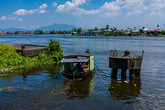 A River in Borneo (Pauls-Pictures) Tags: street city sky people man color colour water ferry work river landscape photography boat long image portait working sarawak malaysia borneo land riverboat rowing longboat worker scape kuching wrok photogaphy