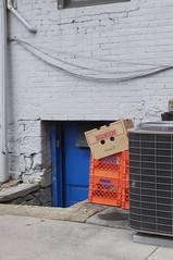 peeking (annburlingham) Tags: street door blue orange face pittsburgh sidewalk pa winner boxes levitating tcf lookslikeaface unanimous thechallengefactory august2014