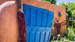 Red chili ristra, blue door and adobe house in Santa Fe, New Mexico (julesnene) Tags: newmexico building cooking architecture display decoration bluesky adobe string welcome bluedoor mudbrick ristra ristras sanfe redchile driedchiles goodluckcharms bluefence redchiles canoneos50d canonefs1755mmf28isusmlens julesnene juliasumangil sundriedearth