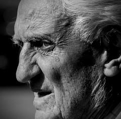 Broadwater portrait (pootlepod) Tags: street shadow portrait blackandwhite man male monochrome contrast silver hair photography grey looking watching elderly staring stphotographia