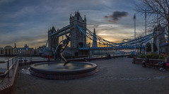 Girl With A Dolphin (scarlet-pimp) Tags: dolphin sunset basculebridge longexposure theshard davidwynne people fountain riverthames statue london suspensionbridge towerbridge canon5dmarkiii outdoors architecture sky 1635mm canon5d places bricks day cityscape
