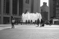 (ReadyAimClick) Tags: city nyc newyorkcity windows people blackandwhite woman water fountain monochrome buildings concrete pavement manhattan citylife met waterfountain lincolncenter metropolitanoperahouse peopleofnewyork womanwearingahat