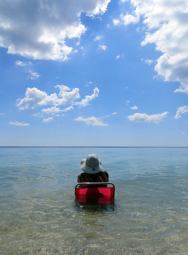 Red chair, woman and the sea (ashabot) Tags: red gulfofmexico nature peaceful beaches blueskies redchair seaandsky womanandthesea