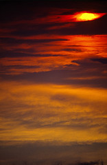 FIRE IN THE SKY !!! (gtsimis) Tags: sunset red orange sun film clouds pentax velvia telephoto slides fujichrome 200mm 50asa pentaxlx analoguephoto