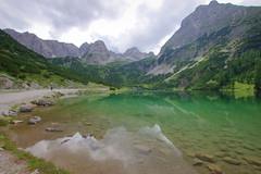 Don't forget your raincoat! (Seebensee, Austria) (armxesde) Tags: lake storm mountains alps reflection austria see tirol österreich pentax berge ehrwald alpen spiegelung wandern k5 seebensee