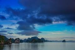 Early morning in Ha Long Bay, Vietnam (CamelKW) Tags: morning blue sky sunrise early vietnam halongbay northernvietnam bluemoment karsthills vietnam2014