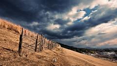 Nara Foothills (samipaju) Tags: japan clouds fence town village widescreen dramatic nara