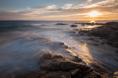 Makedonia (ArztG. Photo) Tags: light sunset sea sky sun seascape motion water clouds canon greek rocks blurred 43 bedrock eliabeach ef1635f28lii