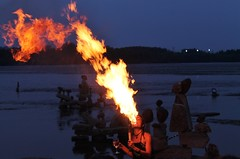 Blowing Fire! (bigbrowneyez) Tags: sunset party hot night festive fun fire twilight dof joy celebration entertainer fabulous notte ottawariver exciting entertaining contento blowingfire happpy rocksculptures bawi remicrapids