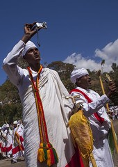 Ethiopian Orthodox Priests Taking Pictures During The Colorful Timkat Epiphany Festival, Lalibela, Ethiopia (Eric Lafforgue) Tags: africa people men church religious outdoors photography togetherness clothing day african faith religion headscarf ceremony multicoloured parade christian celebration event textile devotion males priest christianity shawl spirituality tradition ethiopia ornate orthodox groupofpeople cultures pilgrimage religiouscelebration coptic oneperson developingcountry lalibela humaninterest orthodoxy lifestyles hornofafrica epiphany ethiopian eastafrica brightcolour traditionalclothing realpeople artandcraft amhara onlymen colorpicture timket maturemen timkat africanethnicity artscultureandentertainment africanculture traditionalceremony onlymaturemen copticchristianity colourpicture timqat publiccelebratoryevent religiousequipment celebratoryevent ethio1408041