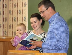 Monte and Kate read Annie her favourite book at an event to celebrate International Literacy Day