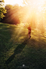 (Rebecca812) Tags: boy sunset shadow sunlight girl vertical freedom sister brother run lensflare carefree runningaway longshadow