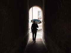 Tunnel (SabineSahm) Tags: rain umbrella regenschirm mann men tunnel durchgang wolfgangsee
