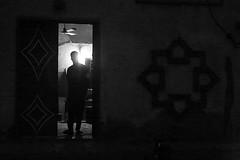 A la porte de l'atelier (Pi-F) Tags: afrique artisanat atelier contrejour travail niamey niger nb nbbwsw porte encadrement nuit sombre lumière atmosphère ambiance homme silhouette