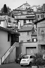 Faith and Fiat are only an H apart (Playing_with_light) Tags: bw italy mountain men car stairs nikon village cross fiat top faith chruch staircase discussion hillside anguillara d800