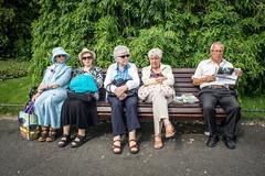 Sunday morning (Giuseppe Milo (www.pixael.com)) Tags: park street ireland dublin man canon bench photography reading photo women europe candid sony canonfd canonfd24mm sonya7