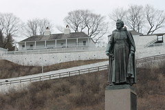 Pre Marquette Statue - Scenes on Mackinac Island (April 30 & May 1, 2014) (cseeman) Tags: horses tourism statue fog docks buildings spring michigan ships foggy churches demolition tourists rainy hotels ferries mackinacisland earlyseason premarquettestatue mackinacisland05012014