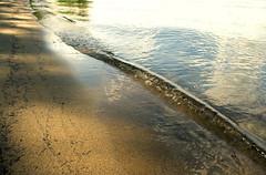 Forward and back (Megan Colleen) Tags: lake ny reflection beach water beautiful sand paradise waves adirondacks shore ripples solace
