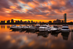 Fiery Sunrise LE over Boston Skyline, Charles River, and Yachts - Cambridge, Massachusetts USA (Greg DuBois Photography) Tags: longexposure morning blue cambridge sky bw orange usa color reflection water silhouette yellow boston skyline clouds marina sunrise canon reflections river boats photography pier movement dock colorful skies cityscape purple unitedstates bright cloudy vibrant massachusetts charlesriver smooth newengland dramatic wideangle financialdistrict ethereal nd mystical yachts waterblur dramaticsky backbay cloudysky glassy memorialdrive waterreflection yachtclub brightcolor bostonskyline johnhancocktower urbanriver bostonmassachusetts cloudmovement colorfulsky cambridgemassachusetts neutraldensity dramaticcolor extremeexposure cloudysunrise backbayboston memorialdrivecambridge fierysunrise canon6d unusualviewsperspectives financialdistrictboston gregdubois gregduboisphotography