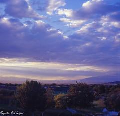 Las Vegas Valley (magnetic_red) Tags: clouds season sunsets monsoon western skys expiredfilm kodakektachrome100vs zenzabronicas2a