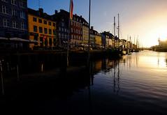 Sunrise in Copenhagen, Denmark (` Toshio ') Tags: toshio copenhagen denmark danish nyhavn sunrise architecture city harbor tallships history boat masts sun reflection europe european europeanunion fujixe2 xe2