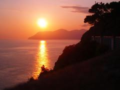 Italian Sunset (ericmshore) Tags: sunset sea italy sun seascape reflection water sunshine silhouette coast warm peaceful calm serene cinqueterre tranquil mediterraneansea riomaggiore waterscape laspezia
