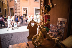 pinocchio (Choo_Choo_train) Tags: wood italy streets rome bicycle shop canon olympus 24mm om pinocchio zuiko manualfocus lazio 242 6d bartolucci 500px