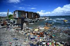 tondo, manila (kk3nt) Tags: ocean kids happy bay garbage philippines dump surfing pollution manila flotsam manilabay slum smokeymountain tondo