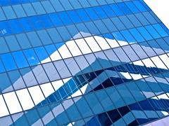 pyramid abstraction - ( Explore! ) (Demetrios Lyras) Tags: blue windows white abstract reflection building art colors architecture angle explore oysterpoint diagonals fav10 fav5 linescurves fav25 anglesanglesangles southsanfranciscocaus pyramidabstraction