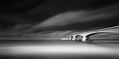Zeeland Bridge (Mabry Campbell) Tags: ocean bridge sea blackandwhite bw seascape holland water monochrome architecture clouds ir photography coast photo europe photographer image fav50 fineart may thenetherlands zeeland fav20 coastal photograph le infrared 100 24mm f80 campbell fav30 fineartphotography waterscape mabry 2014 architecturalphotography schouwenduiveland northerneurope oosterschelde commercialphotography fav10 noordbeveland fav100 fav200 fav300 720nm fav40 zeelandprovince fav60 zeelandbridge architecturephotography fav90 fav80 fav70 ongexposure commercialphotographer tse24mmf35l fineartphotographer architecturalphotographer houstonphotographer architecturephotographer oosterscheldeestuary mabrycampbell may142014 20140514img7608edit 1920sec