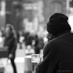 look at the world over the edge of the beer glass (ewaldmario) Tags: wien street city man beer monochrome sterreich nikon focus dof drink pedestrian competition stadt mann beerglass lonesome overtheedge fussgnger haube photographycompetition lookattheworld ewaldmario watchingsit