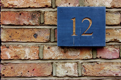 12 wall (Andrea Kennard) Tags: pink blue windows brick green gold doors mosaic number letter ornate digits