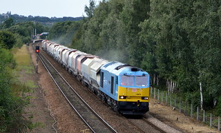60074 powers away from Mexborough with 60063 on the rear of 6E51 Peak Forest to Selby, 12th Aug 2014.