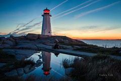 Reflections (Nancy Rose) Tags: sunset lighthouse reflections puddle reflecting bravo couple novascotia peggyscove rainpool 30782