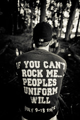 If you cant rock me.... (gstening) Tags: nyc trees summer people blackandwhite white man black guy me rock shirt forest prime blackwhite back uniform dof you sweden bokeh text tshirt cant peoples cap will font if mister 20mm psu basebal primelens canonef50mmf18ii flen sigmaex20mm d peoplesuniform