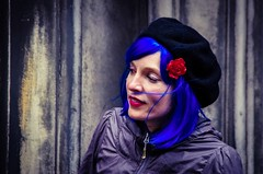 Blue (elizunseelie) Tags: street wood city blue red portrait woman girl smile face hat rose festival electric stone female photoshop portraits hair scotland edinburgh neon pin faces wind theatre pentax head candid scottish blowing fringe blow cap wig royalmile beret oldtown glance k5 flutter berret billowing ipad edfringe psexpress snapseed