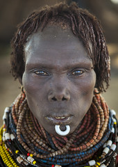 Portrait Of A Nyangatom Tribe Woman With Chin Jewel, Omo Valley, Kangate, Ethiopia (Eric Lafforgue) Tags: africa portrait people haircut vertical closeup hair outdoors necklace women day adult african traditional jewelry tribal blackpeople omovalley braids tradition ethiopia tribe ethnic hairstyle chin anthropology oneperson jewel developingcountry braid labret ethnicity braided hornofafrica ethiopian omo eastafrica traditionalclothing realpeople blackskin bume onewomanonly lookingatcamera colorpicture africanethnicity 1people indigenousculture africanculture ethnicgroup onlywomen bodyadornment oneseniorwomanonly colourpicture nynagatom kangate oneadultonly ngakaaly ethio1401780