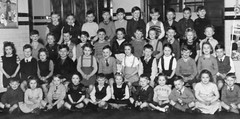 Class photo (theirhistory) Tags: school girls boys children shoes dress sandals skirt badge bow junior jumper shorts wellies primary
