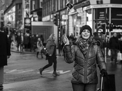 Selfie-Stick, You're Doing It Wrong! (Leanne Boulton) Tags: monochrome people portrait urban street candid portraiture streetphotography candidstreetphotography candidportrait streetlife woman female girl face facial expression look emotion feeling mood atmosphere selfie selfiestick fun humour humours funny smile smiling happiness happy tourism tourist mobile phone tone texture detail depthoffield bokeh naturallight outdoor light shade shadow city scene human life living humanity society culture travel canon canon5d 5dmkiii 70mm character ef2470mmf28liiusm black white blackwhite bw mono blackandwhite glasgow scotland uk