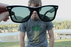 Day 90 (pheebsa) Tags: boy summer lake grass sunglasses happy pineapple forcedperspective raybans