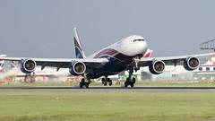 Arik Air ( HiFly ) A340-500 CS-TFX (Adrian Williams P H O T O G R A P H Y) Tags: london airport nikon heathrow air touch down smoking landing airbus 500 runway vr tyres lhr a340 arik 70300 egll hifly 27r d7000 cstfx