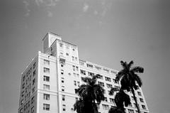 South Beach Apartments (Phillip Pessar) Tags: camera bw white black film beach analog florida kodak miami tx trix samsung x 400 105 tri sobe fino