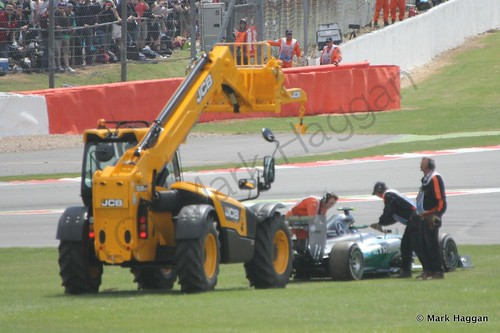Nico Rosberg's Mercedes is recovered during the 2014 British Grand Prix