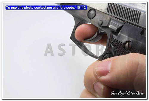 semiautomatic pistol in a hand with white background