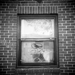 (patrickjoust) Tags: street city urban bw usa white black west 120 6x6 tlr blancoynegro film home window analog america lens fan us reflex md focus mechanical display no flag united north patrick twin maryland baltimore american medium format states manual expired joust orioles ravens trespassing develop estados 80mm f35 blancetnoir filmphotography unidos sowebo fomapan rebranded schwarzundweiss aristaeduultra100 originalphotography autaut rebadged patrickjoust amiflex developedinxtol11 photographersontumblr