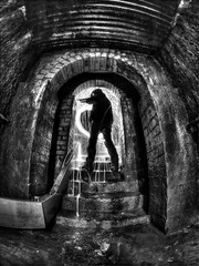 Monday Night Attraction (MM ) Tags: blackandwhite bw lightpainting brick wet silhouette newcastle underground mono steps arches paintingwithlight mm toned 8mm tyneside corrugated playingwithlights wirewool waggonway bulbmode victoriatunnel