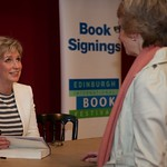 Sally Magnusson signs copies of her book for Book Festival audience members
